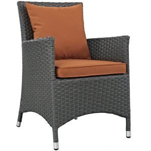 Rattan dining chair with tuscan orange cushion