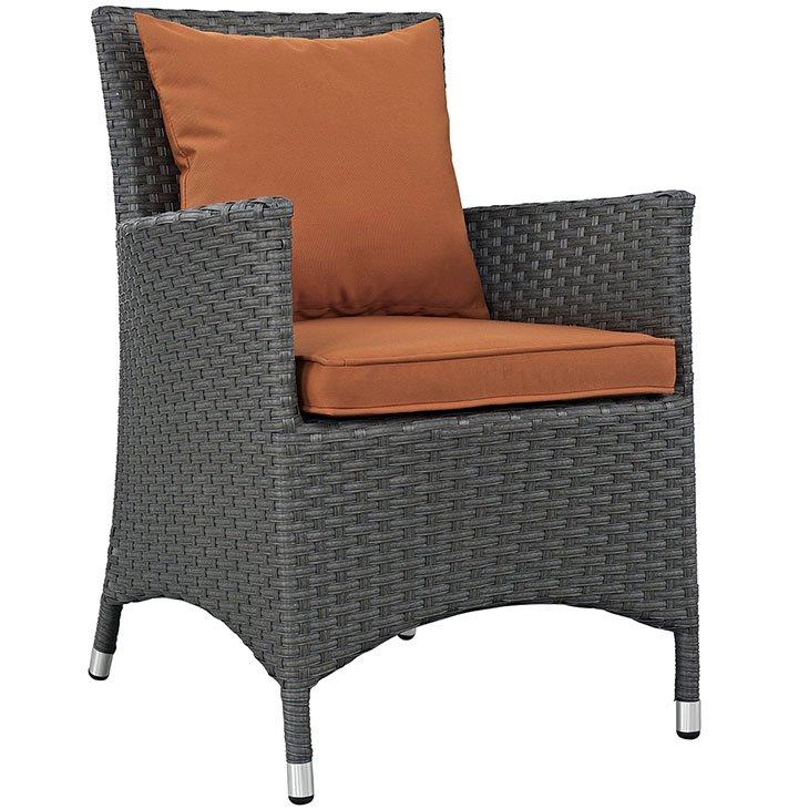 Rattan dining chair with tuscan orange cushion