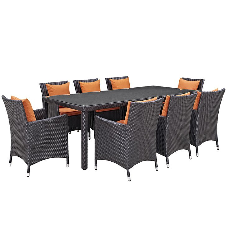 9 piece rattan patio dining set with orange cushions