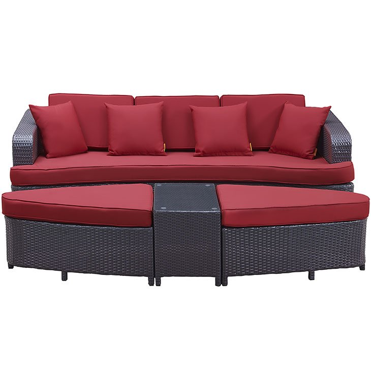 Rattan patio sofa set with red cushions