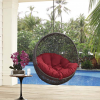 Hanging chair with red cushion