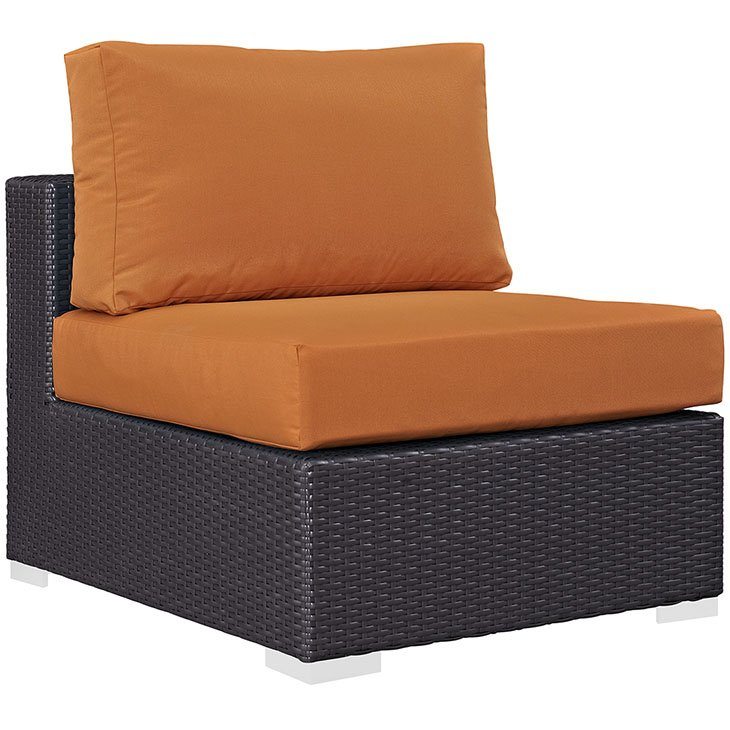 Rattan armless chair with orange cushions