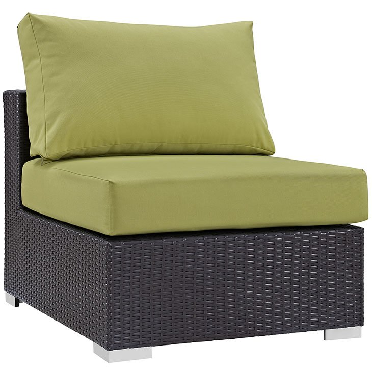 Rattan armless chair with green cushions