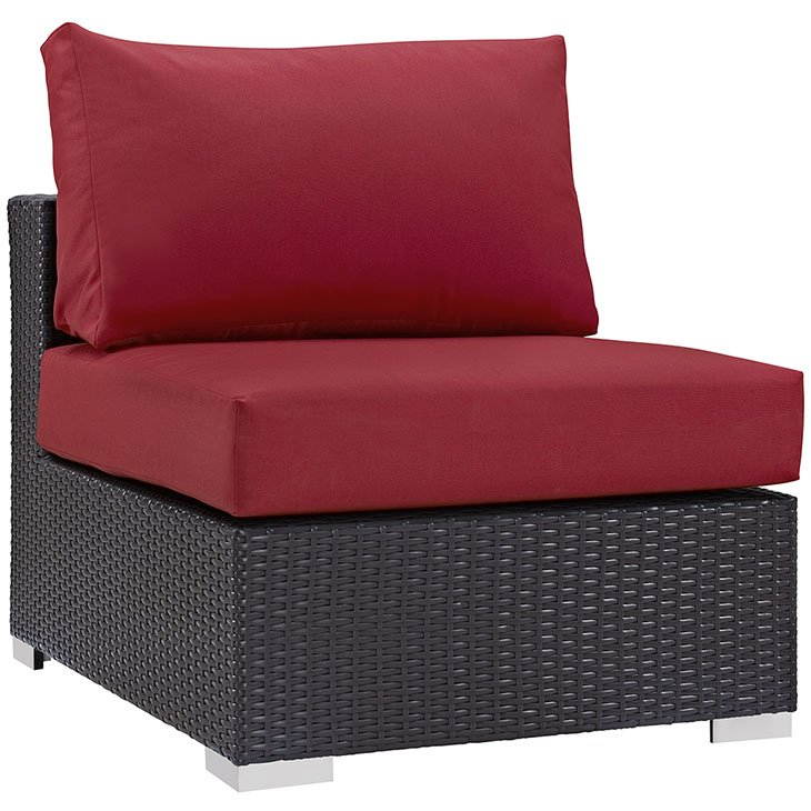 Rattan armless chair with red cushions