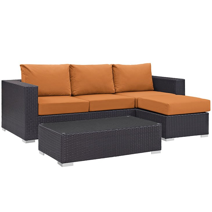 Orange Cushions on Rattan Sofa Set
