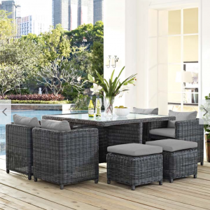 9 piece rattan patio dining set with gray cushions